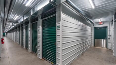 Exit door and indoor, climate controlled units at National Storage Centers in Comstock Park, MI.