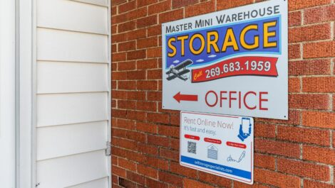 Master Mini Warehouse office sign with phone number 2 6 9 6 8 3 1 9 5 9.