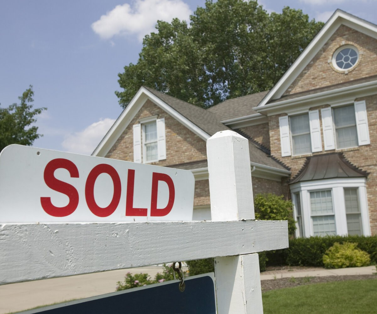 A sold sign in front of a house