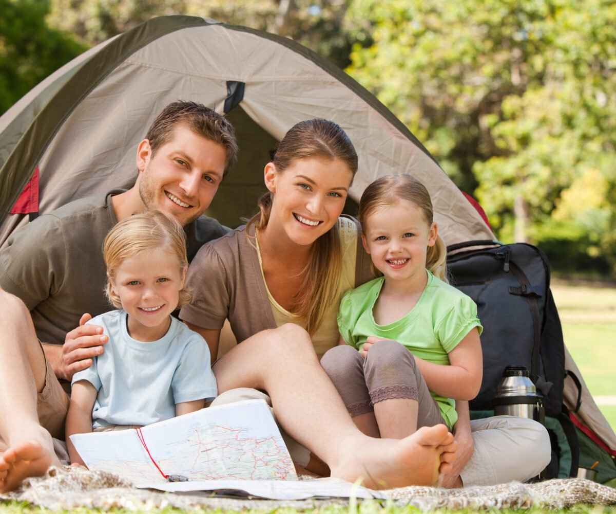 A family enjoys camping at an Ann Arbor or Grand Rapids Campsite