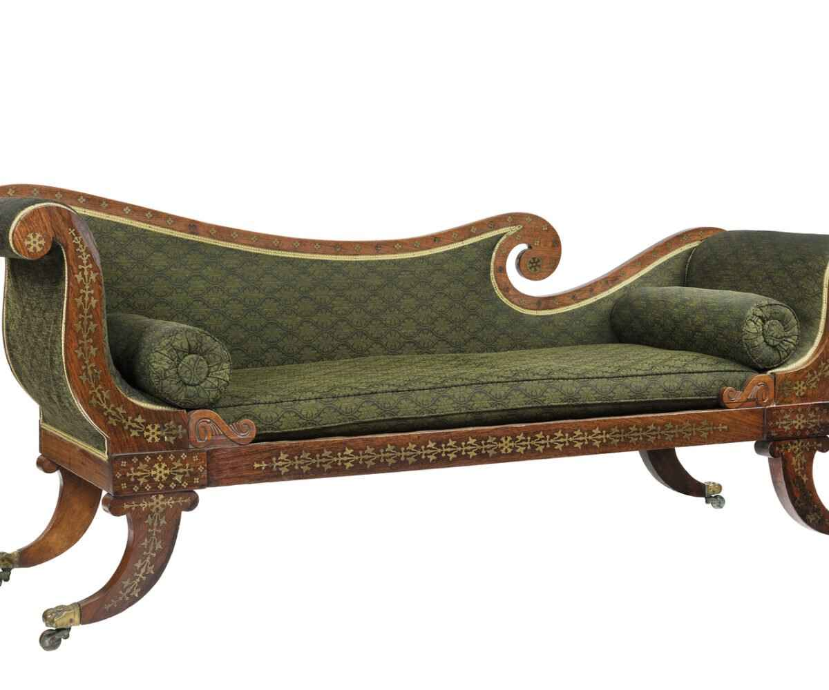 An antique chaise before it is placed into an antique storage unit