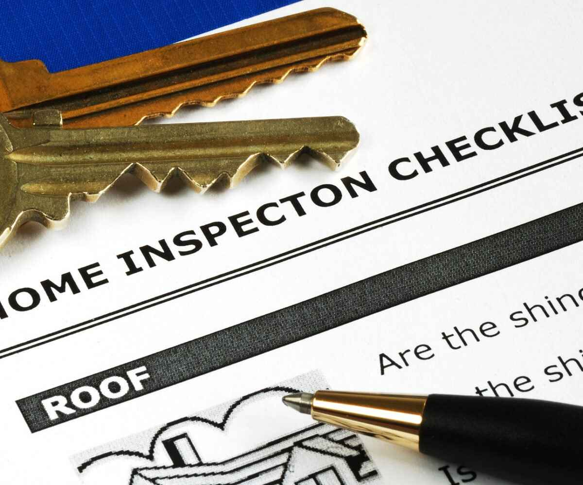 A home inspector report with keys