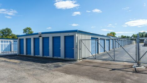 A Plus Self-Storage - Swartz Creek drive-up units and security gate.