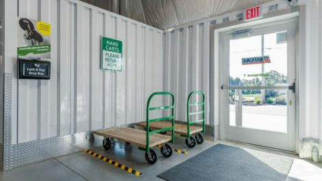 Hand carts by an access door at National Storage Centers in Byron Center, MI.