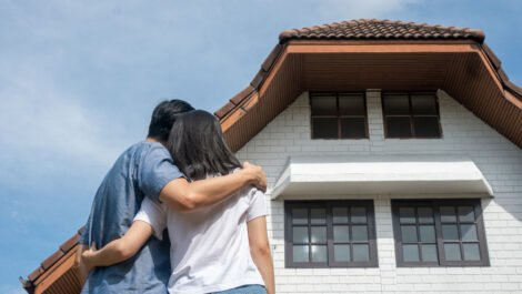 Couple looking at a house.
